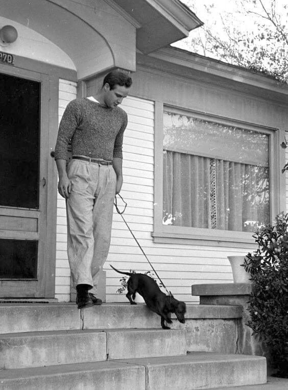Marlon Brando walking his doxie